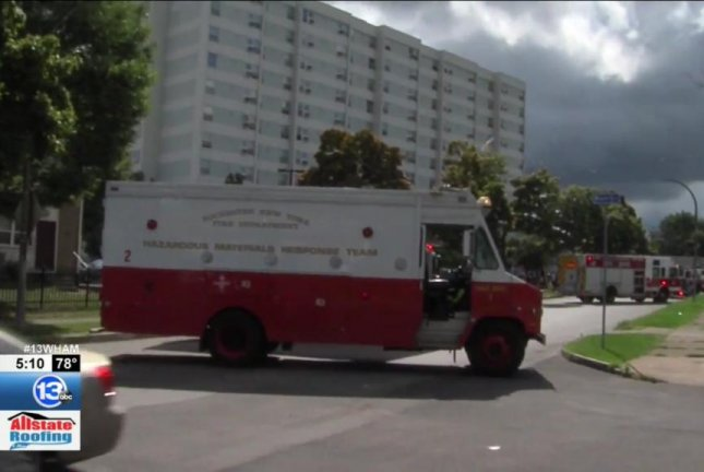 A hazmat team was called to an apartment building in Rochester, N.Y., after a resident microwaved a hot pepper, causing complaints about other residents having trouble breathing. Screenshot: WHAM-TV