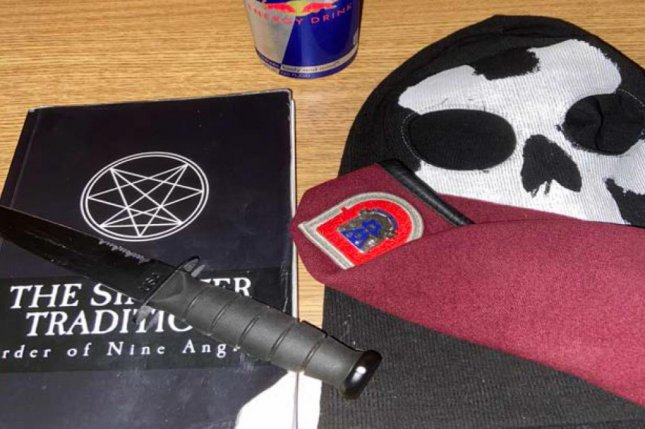 A photo found in Ethan Melzer's iCloud account that was included in the criminal complaint shows a knife, a neo-Nazi book, a skull mask and a U.S. Army beret. Photo courtesy of U.S. Attorney' Office.