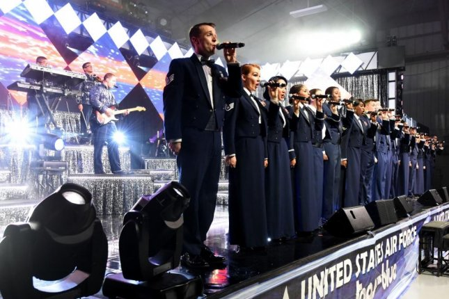Tops in Blue closes out the show with a rendition of the Air Force song while in their mess dress at an October 2015 event in North Carolina. Photo by Aaron J. Jenne/U.S. Air Force