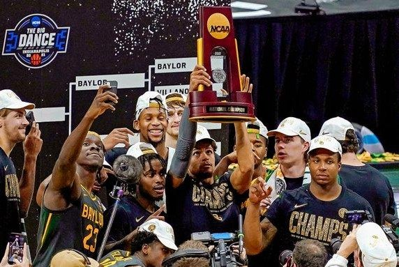 The Baylor men's basketball team celebrates its first NCAA championship victory Monday night in Indianapolis. Photo courtesy of Baylor Athletics