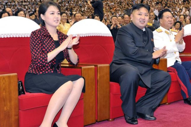North Korea's first lady, Ri Sol Ju, shown here at a 2012 performance with Kim Jong Un, is rarely seen in public but she is often carrying an expensive French purse. Photo by KCNA