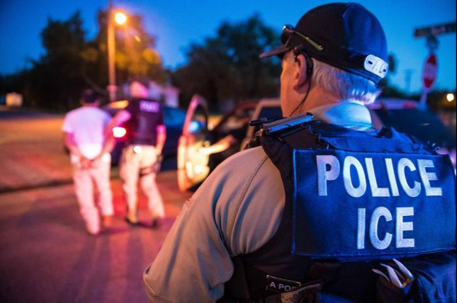 A person is arrested by U.S. Immigration and Customs Enforcement during a four-day raid in Texas and Oklahoma in late June. ICE said Monday a 30-year-old Honduran man died in its custody on Sunday. Photo by Immigration and Customs Enforcement