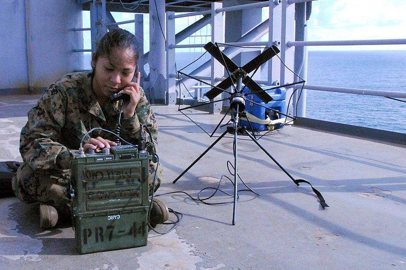 A U.S. Marine operates a Harris wideeband radio using a satellite antenna. U.S. Navy photo by Mass Communication Specialist 1st Class Leslie L. Tomaino.