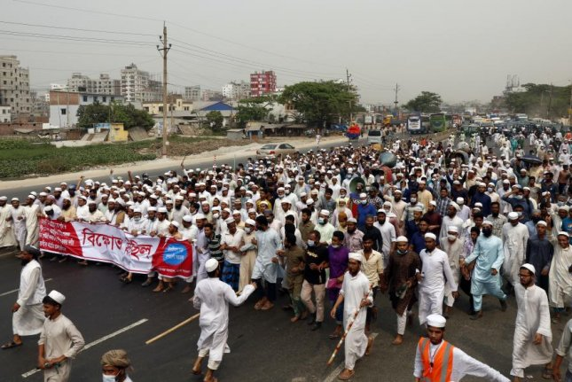 Members of the Bangladeshi Islamic group Hefazat-e Islam take part in a protest march at the Dhak- Narayanganj high way in Dhaka, Bangladesh, Saturday. The protest comes a day after clashes at the Baitul Mukarram Mosque between police and activists opposed to Indian Prime Minister Modi's visit to Bangladesh. Photo by Monirul Alam/EPA-EFE