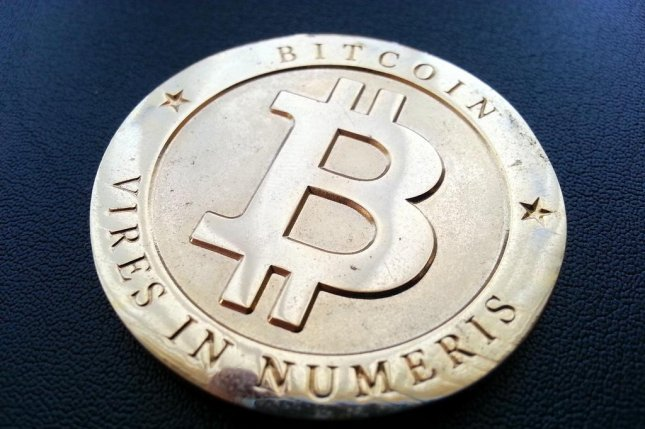 A medallion bearing the Bitcoin digital currency logo. CC/Zach Copley
