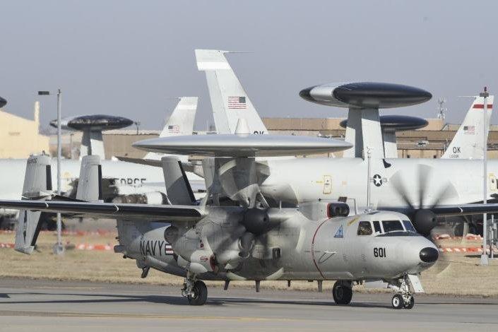 A Navy E-2C Hawkeye Airborne Early Warning aircraft, Naval Aviation Warfighting Development Center, Naval Air Station Fallon, Nevada, taxis toward the runway. Photo by Greg L. Davis/U.S. Navy