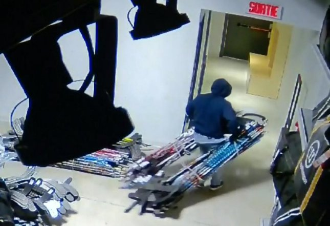 Thief rappels into Canadian sports store to steal $120,000 worth of hockey sticks