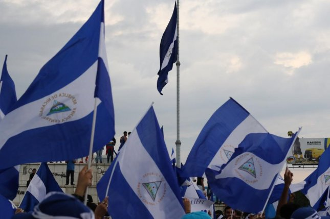 Protesters wave Nicaraguan flags during an anti-government demonstration near the University of Central America in Managua, Nicaragua, on Friday. On Wednesday, 16 people died in protests across the country, according to the Nicaraguan Center for Human Rights. Photo by Ray Downs/UPI