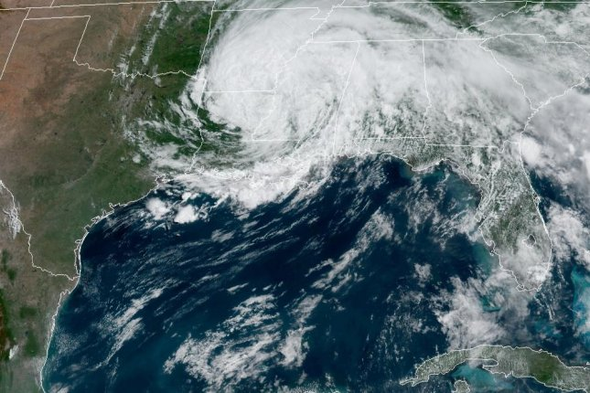 Tropical Depression Cristobal is seen over Louisiana on Monday afternoon about a day after making landfall. Image courtesy NOAA