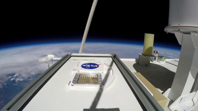 The MARSBOx payload is pictured testing the survival of microbes in the Earth's middle stratosphere -- about 23 miles from the Earth's surface -- with the shutter open and exposing the top layer samples to UV radiation. Photo by NASA