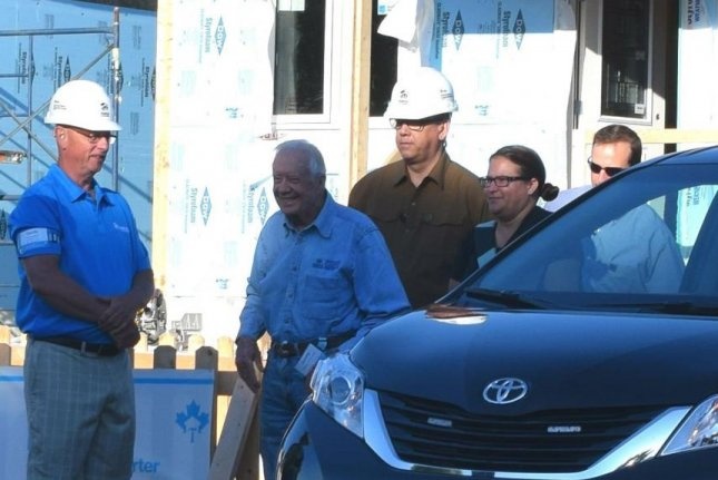 Former President Jimmy Carter (C) left a hospital in Winnipeg, Canada, Friday morning, one day after he collapsed from dehydration. Photo courtesy of Habitat for Humanity/Twitter