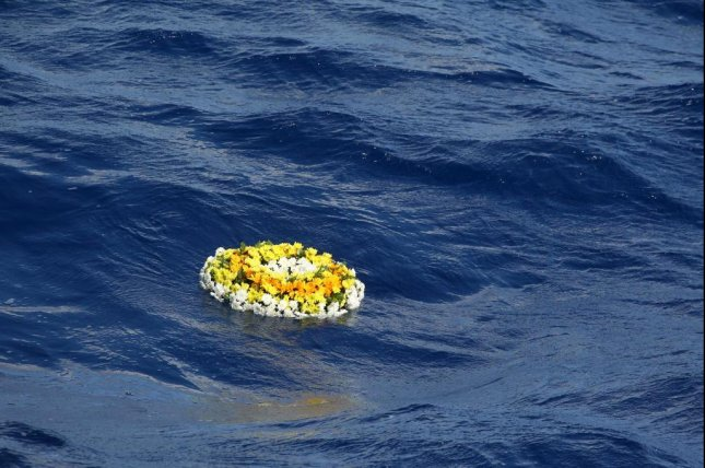 The wreath of flowers launched by a coast guard boat in the Mediterranean Sea in October to mark migrant deaths. United Nations officials said 58 migrants died off the northwest coast of Africa Wednesday. Photo by Pasquale Claudio Montana Lampo/EPA-EFE