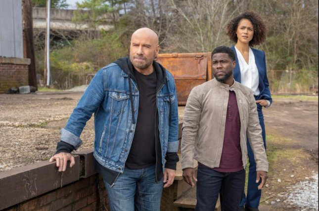 """John Travolta (L), Kevin Hart and Nathalie Emmanuel star in the new comedy series, """"Die Hart."""" Photo by Kevin Kwan/Quibi"""