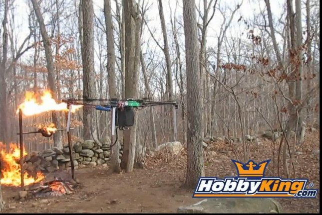 A flamethrower mounted to a drone shoots off fire to roast a turkey. Hogwit/YouTube video screenshot