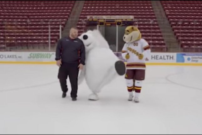Car dealership mascot White Bear takes one of many tumbles while filming a commercial. Screenshot: whitebearautos/YouTube