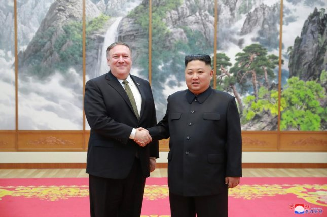 A photo released by the official North Korean Central News Agency (KCNA) shows North Korean leader Kim Jong Un shaking hands with United States Secretary of State Mike Pompeo during their meeting in Pyongyang, North Korea, on Monday. EPA/KCNA