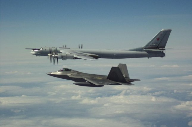A U.S. F-22 fighter jet flies alongside a Russian Tu-95 bomber Tuesday off the northern coast of Alaska. Photo courtesy NORAD Command/Twitter