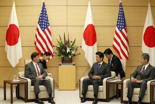 U.S. Secretary of Defense Mark Esper (L) meets with Japanese Prime Minister Shinzo Abe (3-R) and Defense Minister Takeshi Iwaya (R) at Abe's official residence in Tokyo on Wednesday. Photo by Issei Kato/EPA-EFE