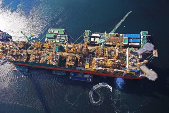 Prelude, the largest offshore production facility of its kind, has left a shipyard and is on its way to a basin off the coast of Australia, Royal Dutch Shell announced. Photo courtesy of Royal Dutch Shell