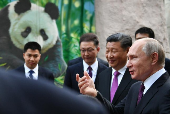 Russian President Vladimir Putin (R) and Chinese President Xi Jinping (2-R) attend an official ceremony to hand over two giant pandas from China to the Moscow Zoo on Thursday. Photo by Alexander Vilf/EPA-EFE/Sputnik/Kremlin Pool