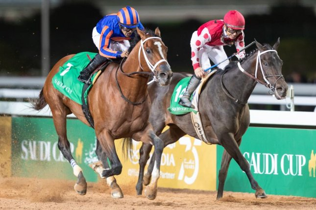 Maximum Security in blue and orange silks) wins the inaugural $20 million Saudi Cup, the richest horse race in the world, on Friday at King Abdulaziz Racecourse in Riyadh. Photo by Neville Hopwood, courtesy of the Jockey Club of Saudi Arabia