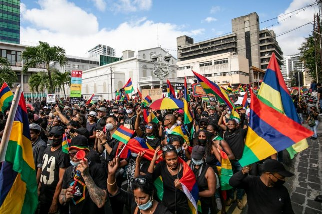 People during a protest over the governments handling of the Wakashio oill spill in Port Louis, the capital of Mauritius, Saturday. Citizens and various political parties denounced the government's handling of the Wakashio case. Photo by Lura Morosoli/EPA-EFE