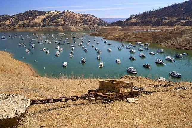 Memorial Day holiday boaters are seen at Lake Oroville in Northern California on Monday. Meteorologists say the lake is severely low due to drought conditions. Photo byFrank Schulenburg/Wikimedia Commons(unmodified)