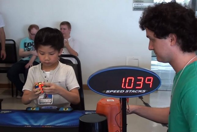 A 7-year-old boy solves a Rubik's cube in 8.72 seconds in Brazil. Chan Hong Lik/YouTube video screenshot