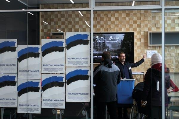 People prepare to vote in the 2019 Estonian parliamentary election, when 43.8% of all participants voted over the Internet. File Photo by Valda Kalnina/EPA-EFE