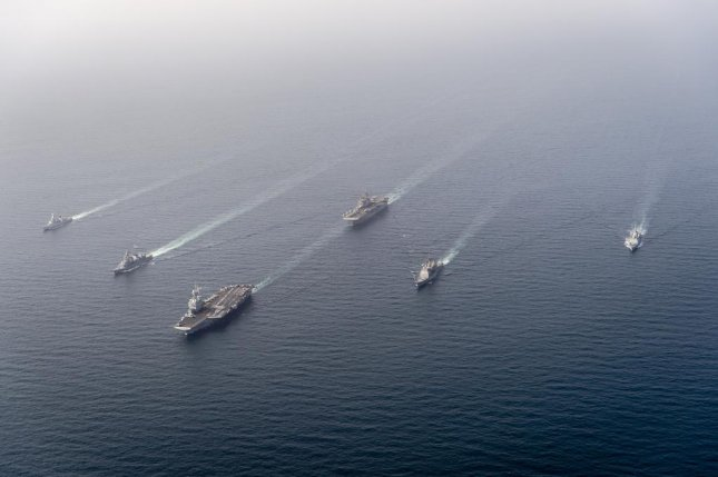 The French aircraft carrier Charles de Gaulle, along with the US guided-missile cruiser Port Royal and the US amphibious assault ship Makin Island, the Belgian frigate Leopold the 1st, the Japanese destroyer Ariake, and the French frigate Provence, participated in the Group Arabian Sea Warfare Exercise this weekend. Photo courtesy U.S. Navy/Marine nationale