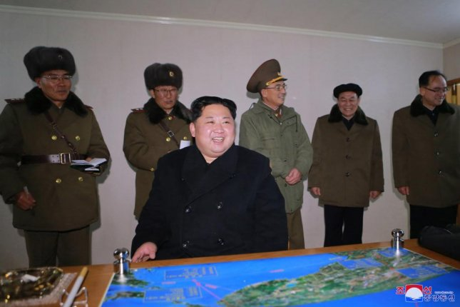 A photo released by the North Korean Central News Agency (KCNA), the state news agency of North Korea, on Nov. 30, 2017, shows North Korean leader Kim Jong-un (C) giving an order to test-fire the newly developed inter-continental ballistic missile Hwasong-15 from an undisclosed location in North Korea, 29 November 2017. KCNA/EPA-EFE