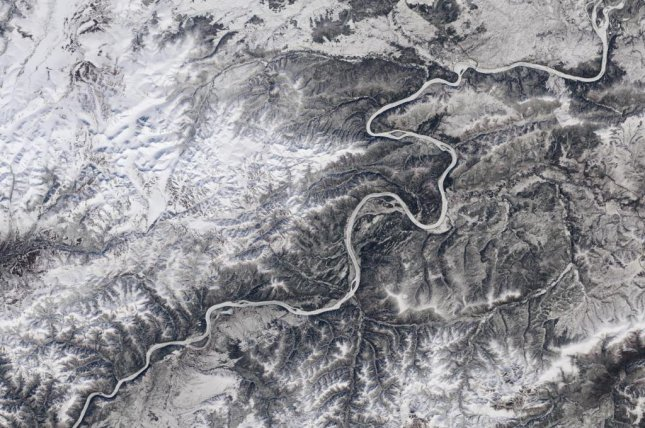 New research suggests rising temperatures will decrease the number of days rivers remain frozen each year, especially rivers in Alaska's Yukon. Photo by Landsat imagery/NASA Goddard Space Flight Center and U.S. Geological Survey