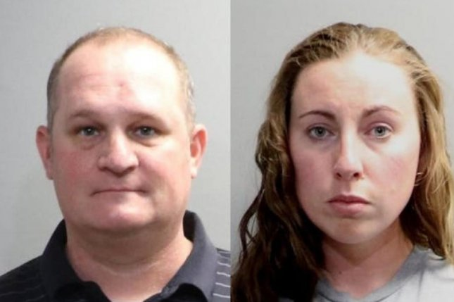 Eric, 42, and Jillian Wuestenberg, 32, were charged with felony assault after Jillian Wuestenberg allegedly pulled a gun at an unarmed black woman and her daughters in a Michigan Chipotle parking lot. Photo courtesy Oakland County Sheriff's Office