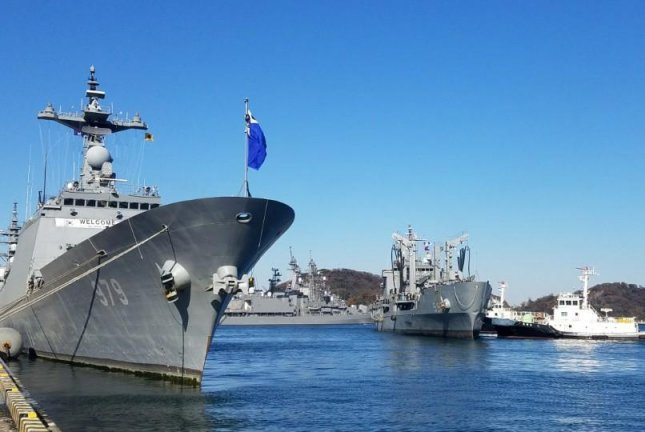 South Korea's 4,400-ton destroyer, the Ganggamchan (L), and 4,100-ton logistic supporting vessel, the Hwacheon, make a port call to the Japanese port city of Yokosuka, Kanagawa Prefecture, on Monday. Photo by Yonhap