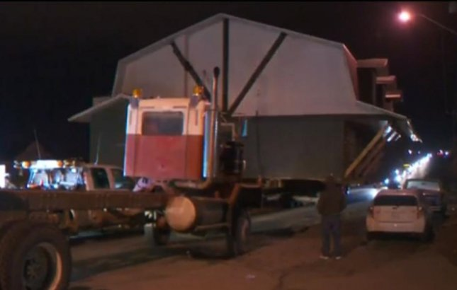 Traffic was halted on a Canadian highway when a house became stuck on a nearby train track. The house was being hauled along Highway 566 in Alberta when the flatbed truck carrying it suffered a flat tire. Screen capture/CTV News.