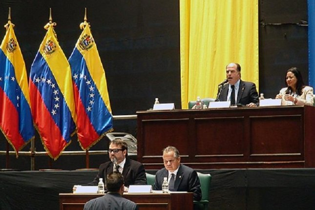 Julio Borges (top, 2nd L), president of Venezuela's National Assembly, has condemned Goldman Sachs' purchase of $2.8 billion in bonds from the state-run Petróleos de Venezuela, S.A., or PDVSA, oil company for a discounted $865 million. Photo courtesy of National Assembly