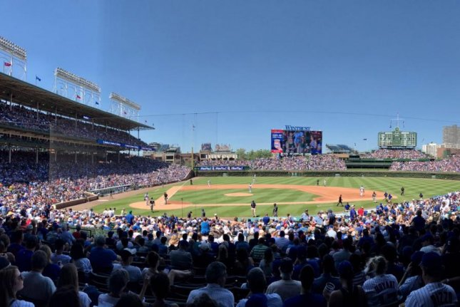 The Rockies' Mark Reynolds and Charlie Blackmon took advantage of the wind blowing out at Wrigley Field today to launch home runs out of the park in a 9-1 victory. Photo courtesy Chicago Cubs/Twitter