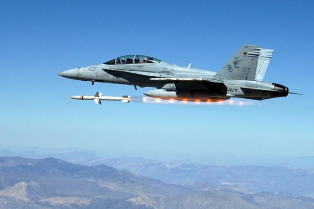 A Navy fighter fires an AGM-88 Advanced Anti-Radiation Guided Missile. U.S. Navy photo.