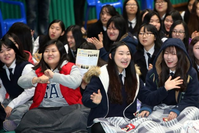 South Korean teens celebrate the completion of their university exams. Young South Koreans have said economic issues and the pressure to get top marks in school were behind the chronic stress they experienced in their daily lives. Photo by Yonhap.