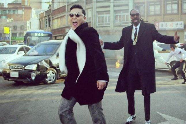 The South Korean singer PSY with artist Snoop Dogg in a cross-over music video, Hangover, released in 2014. Korean language learning is soaring in the United States, thanks to the rising popularity of Korean pop music and films. Photo by OfficialPsy/YouTube