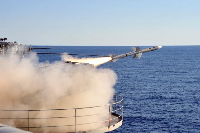 DARPA's MAD-FIRES program aims to develop interceptor ammunition with the guidance capability of a missile and the speed and rapid-fire capabilities of conventional bullets. Pictured: An intercept-aerial guided missile is launched from a NATO Sea Sparrow launcher during a live-fire exercise. U.S. Navy photo by Mass Communication Specialist 3rd Class Tiger Martinez