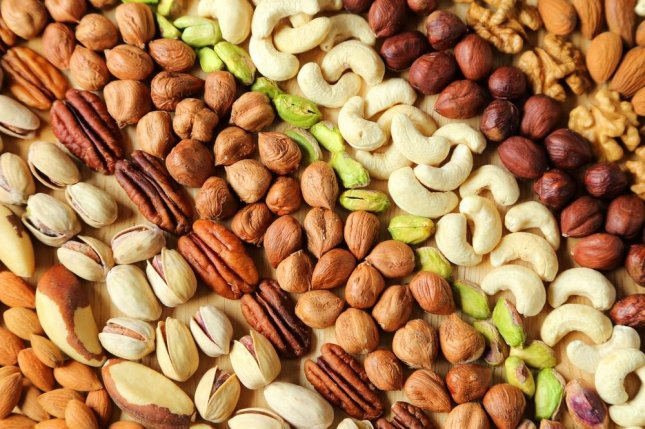 Researchers say eating a serving of nuts five or more times per week can reduce inflammation and risk for diseases it plays a role in. Photo by Krzysztof Slusarczyk/Shutterstock