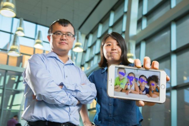 The program was developed by college student Kun Woo Cho (R), with help from Wenyao Xu (L), an assistant professor at SUNY Buffalo. Photo by University at Buffalo