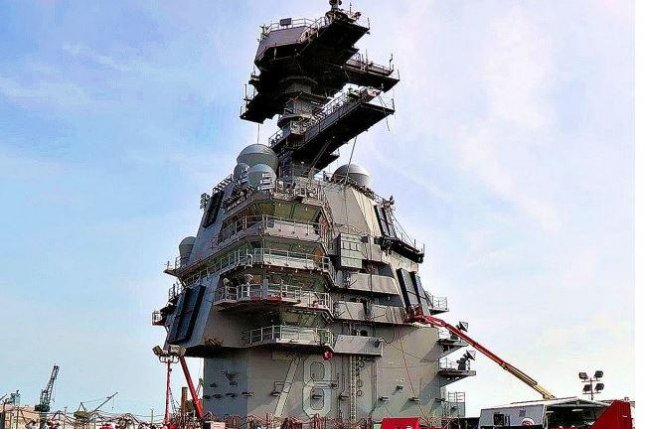 A radar array sits atop the island of the aircraft carrier USS Gerald R. Ford. Raytheon Co. was awarded a $40.2 million contract modification for work on maritime radar systems, the Defense Department announced on Tuesday. Photo courtesy of U.S. Navy/UPI