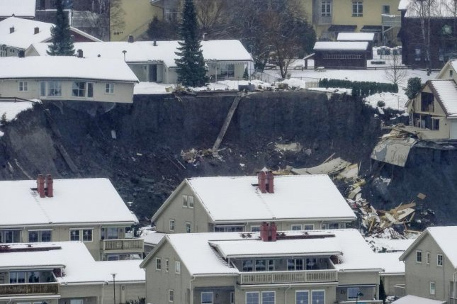 Officials said the landslide in Ask, which happened before dawn Wednesday, was roughly 2,300 feet long and dozens of feet wide. Photo by Fredrik Hagen/EPA-EFE