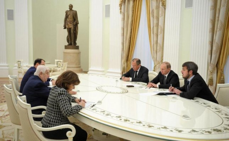 Syrian President Walid Moulaaem, center left, met Monday with Russian President Vladimir Putin, center right. Photo courtesy of The Kremlin.