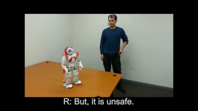 A robot rejects a Tufts University researcher's command to walk forward because it would mean putting itself at risk of harm. HRI Laboratory at Tufts University/YouTube video screenshot