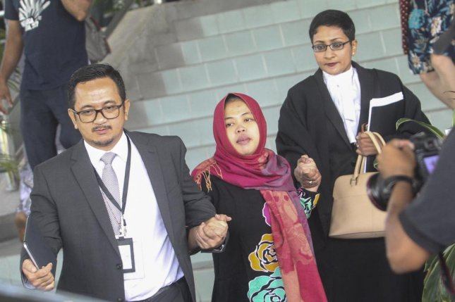Siti Aisyah, center, leaves the Shah Alam High Court, Shah Alam, Malaysia after prosecutors withdraw murder charges against the Indonesian suspect. Photo by EPA-EFE/STR MALAYSIA OUT