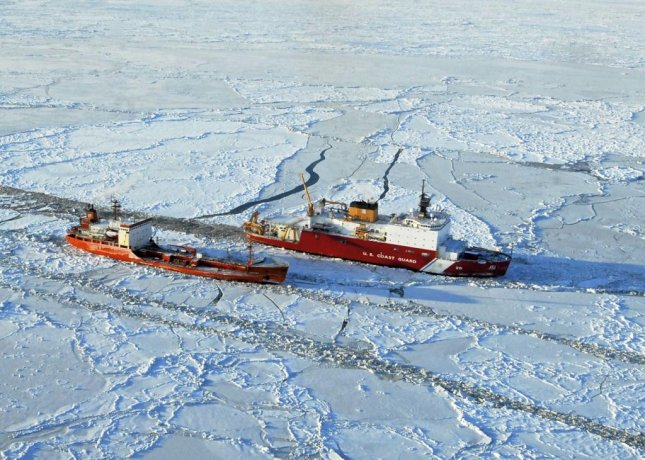 The ice-strengthened Russian oil tanker Renda, in the foreground, is escorted by the U.S. Coast Guard cutter Healy. Photo by Petty Officer 1st Class Sara Francis/U.S. Coast Guard