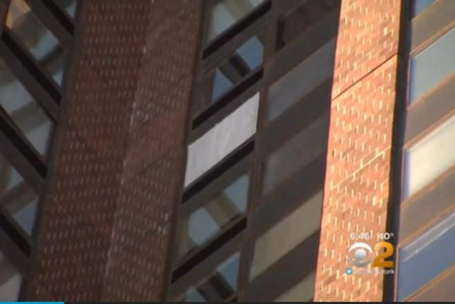 A window is boarded up on the 27th floor of a New York high rise after a drone crashed into a woman's apartment. Screenshot: CBS New York